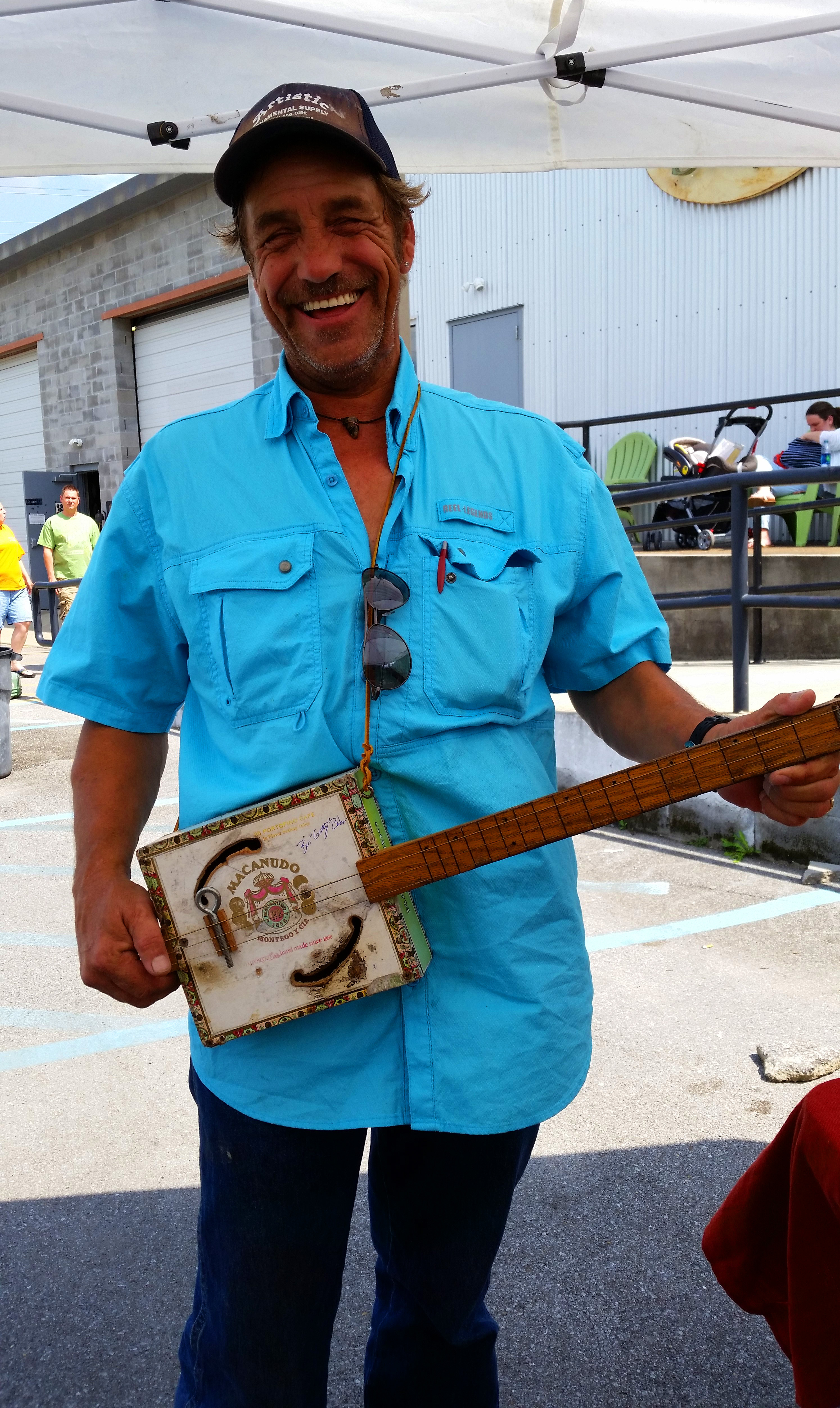 Eric Salhoff with his well-worn Cigar Box Guitar