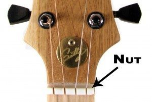 This photo shows an example of a standard bone nut in use on a four-string cigar box guitar.