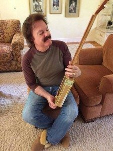 This is Tom Johnston, one of the founders of the Doobie Brothers, checking out a cigar box guitar made for him by Greg Campbell.