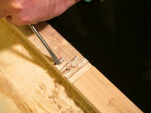 chisel out the notch in the neck