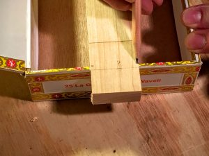 mark the inside edge of the back of the cigar box on the neck