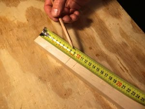 measure down from the top of the neck to the bottom of the headstock