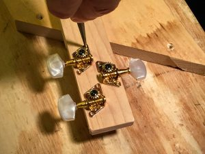 prepare the headstock for tuning peg mounting screws