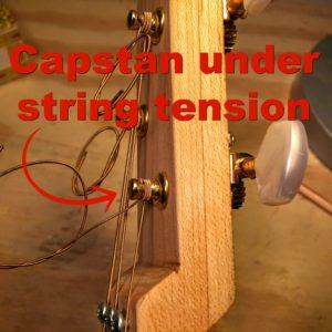 string wound around capstan of an open gear tuner