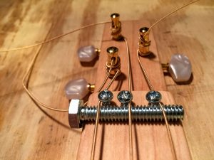 strings over the nut and under the string retainers