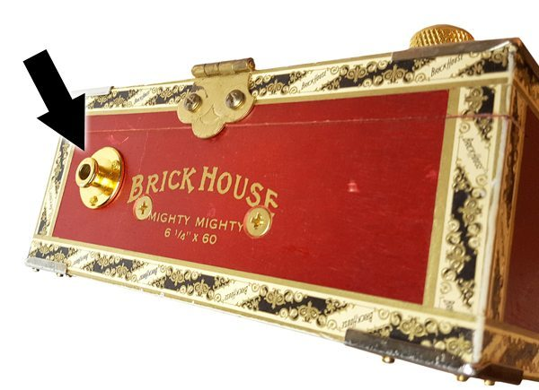 This cigar box guitar utilizes a gold strap button endpin jack from C. B. Gitty