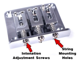 This chrome 3-string hard-tail bridge is a top-loading variety. Note the string holes visible beneath the adjustment screws. Available from CBGitty.com.