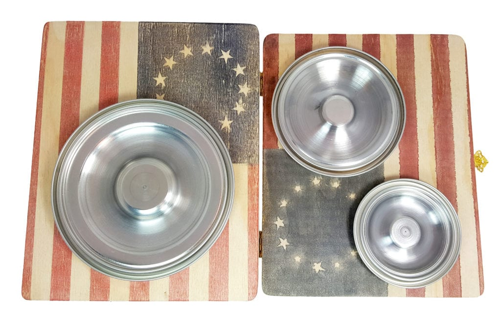 3 different sized Hubcap Resonator Cones on an old American Flag graphic-inked box top